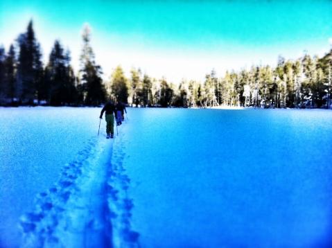 Skiers crossing lake