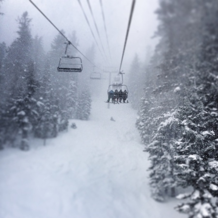 Snowy chairlift ride